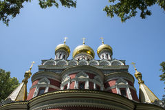 Golden church domes. Church dome front view with blue sky Royalty Free Stock Images
