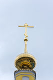Golden Church steeple with a cross. Royalty Free Stock Photo