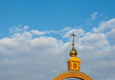Golden Church steeple with a cross. Royalty Free Stock Image
