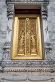 Golden church window in Thailand. Stock Photography