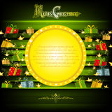 Golden circle frame on green christmas background with golden stars and presents Stock Images