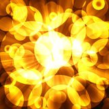 Golden circles on a dark background Stock Image