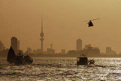 Golden City. This is a scene of Kuwait city during a marine show - the tower shown in the photo is Kuwait liberation tower - the weather was dusty which is Stock Images