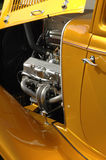 Golden Classic Car. Open hood of a golden metallic classic car Stock Photography
