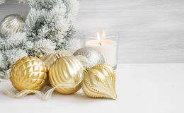 Golden Classic Christmas Globes and Candle with Snowy Wreath in Stock Photo