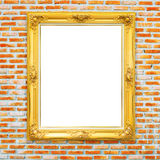 Golden classic photo frame on bricked wall background Royalty Free Stock Images