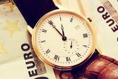 Golden classic watch  on Euro banknotes Royalty Free Stock Images