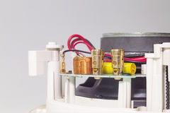 Golden clips on a white loudspeaker. Close view stock photos