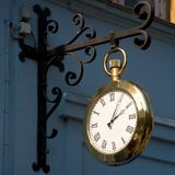 Golden clock. In the street of Karlovy Vary, Czech Republic Royalty Free Stock Images