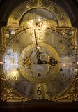 Golden clock. Big vintage golden clock close-up Royalty Free Stock Photo
