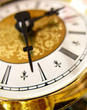 Golden clock. Closeup and details of an old decorated golden clock Royalty Free Stock Images