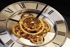 Golden Clock. With gears and latin digits Royalty Free Stock Image