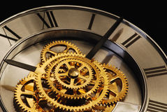 Golden Clock. With gears and latin digits Stock Image