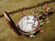Golden clock with butterflies Royalty Free Stock Images
