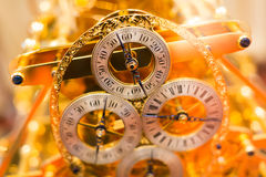 Golden clock. Closeup shot of a golden vintage clock Stock Photos