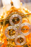 Golden clock. Closeup shot of a golden vintage clock Stock Image