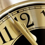 Golden Clock Face Closeup. Golden clock face. Closeup on two minutes to midnight Royalty Free Stock Images