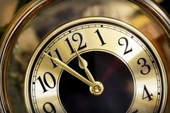 Golden Clock Face Five Minutes to Midnight. Golden clock face. Hands showing five minutes to midnight Stock Photos