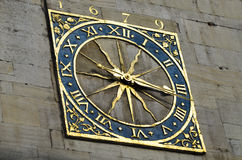 Golden Clock. The golden clock found on St Marry`s church in Cambridge, England, Uk Royalty Free Stock Photo