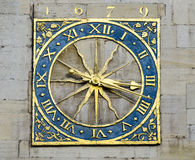 Golden Clock. The golden clock found on St Marry`s church in Cambridge, England, Uk Stock Photo