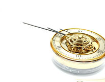 Golden Clock with gears. On white Stock Photos