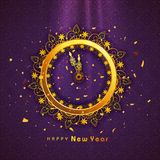 Golden clock for Happy New Year celebration. Beautiful floral decorated golden clock showing almost Twelve 'O' clock on shiny purple background for Happy New Royalty Free Stock Photos
