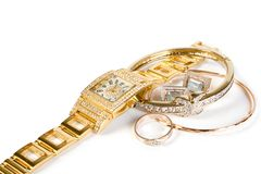 Golden clock and jewellery. Isolate on white background Royalty Free Stock Photography