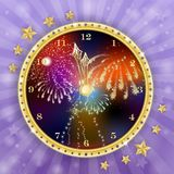 Golden clock for new year over fireworks background. Golden clock for new year over fireworks and blue background Royalty Free Stock Image