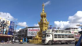 Golden clock tower on the city square on a sunny day. Chiang Rai, Thailand