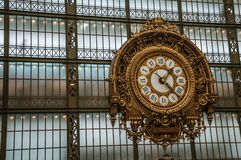 Golden clock view at the main hall of the Quai d`Orsay Museum in Paris. royalty free stock photos
