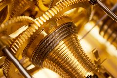 Golden Clockwork. Close view on golden cogs and wheels Royalty Free Stock Image