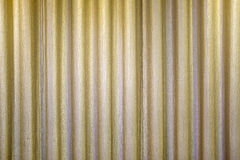 Golden Closed Curtain with Light Spot on the Stage. Golden Closed Curtain with Light Spot Stock Photo