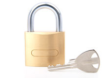 Golden closed padlock with key Royalty Free Stock Photos