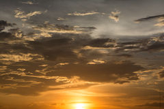 Golden cloud in the sky during sunset. Otherwise it can be use as a picture for cover books and it use to be a picture of sunrise Royalty Free Stock Images