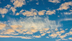 Golden Clouds on the Background of the Sunset Sky Royalty Free Stock Image