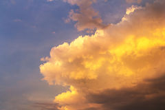 Golden clouds on blue sky Royalty Free Stock Photo