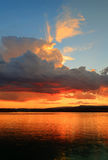 Golden clouds at a desert lake. Royalty Free Stock Photo