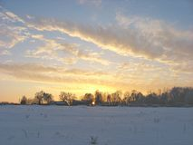 Golden clouds in the evening sky. Clouds evening sky dark blue winter snow sunset landscape beautiful cold royalty free stock photo