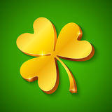 Golden clover on the green background. Golden clover on green background for St. Patrick's day Royalty Free Stock Photo