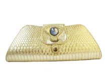 Golden Clutch. A golden clutch ladies purse on a white background Stock Photo