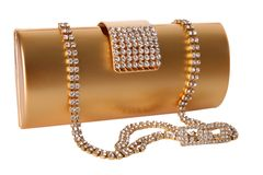 Golden clutch bag Stock Photos