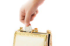 Golden clutch and coin ,closeup, Royalty Free Stock Photo
