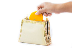 Golden clutch and gold coin ,closeup, Royalty Free Stock Image