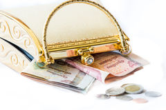 Golden clutch and money ,closeup, Stock Images