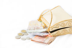 Golden clutch and money ,closeup, Stock Photography