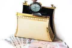 Golden clutch ,money and pocket watch ,Time and financial concep Royalty Free Stock Image