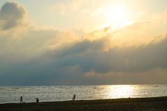 Golden Coast. The largest beach within Tainan city. There are always lots of tourists walking, splashing in the waves and flying kites here in the afternoon stock photography