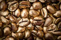 Golden coffee beans. background. texture Royalty Free Stock Photography