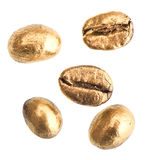 Golden coffee beans isolated on white Royalty Free Stock Images