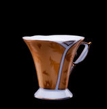 Golden coffee cup on black background Royalty Free Stock Photo